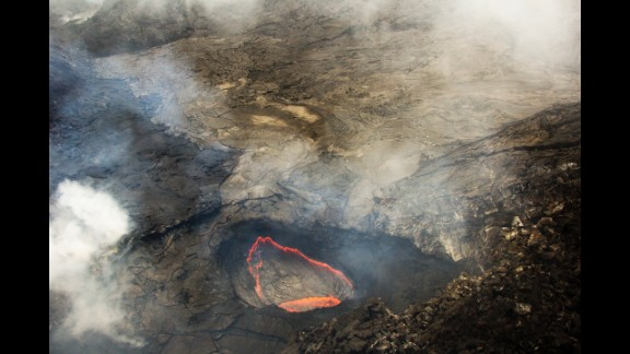 Pu'u O'o Crater, in the eastern rift zone of Kilauea, remains filled with thick fumes, but recent views with the naked eye and thermal camera confirm that little change has occurred in the crater over recent weeks. The fumes mask a handful of small, glowing openings on the crater floor.