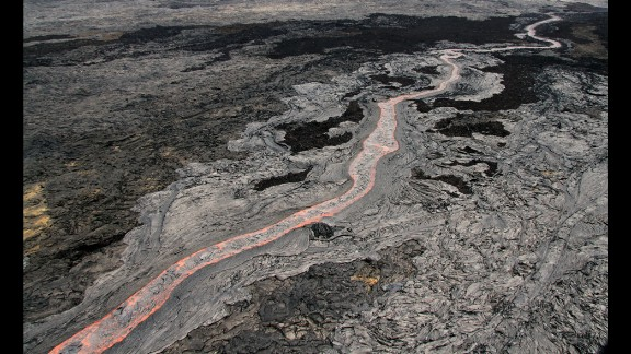 A view of the sinuous, channelized flow that was moving to the northeast from Kilauea on June 27. The flow threatening Pahoa has advanced about 13 miles (21 kilometers) since then. Kilauea is one of the world
