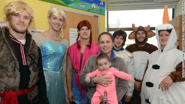 Boston Bruins, from left, Kevan Miller (Kristoff), Dougie Hamilton (Elsa), Matt Fraser (Anna), Seth Griffith (Hans), Matt Bartkowski (Sven) and Torey Krug (Olaf) spent time with patients and parents at Boston Children's Hospital.