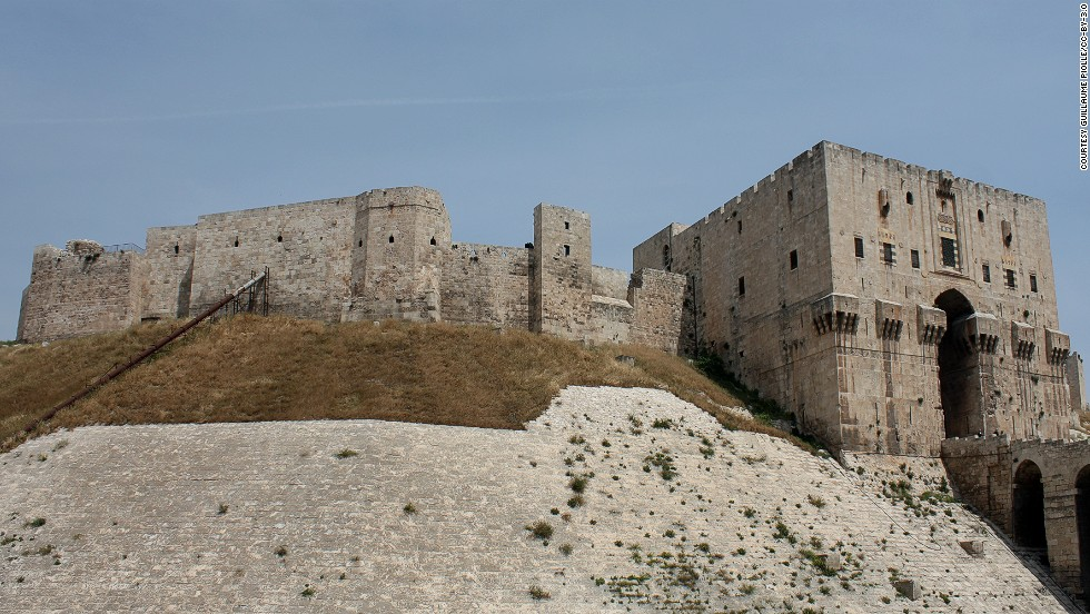 "The fortress spans at least four millennia, from the days of Alexander the Great, through Roman, Mongol, and Ottoman rule. The site has barely changed since the 16th century and is one of Syria's most popular World Heritage sites. The citadel has been used as an army base in recent fighting and several of its historic buildings <a href=""http://projects.nytimes.com/watching-syrias-war/footage-shows-damage-to-aleppo-citadel"" target=""_blank"">have been destroyed</a>."