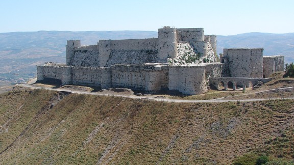 The Crusader castle from the 11th century survived centuries of battles and natural disasters, becoming a World Heritage site in 2006 along with the adjacent castle of Qal'at Salah El-Din. The walls were severely damaged by regime airstrikes and artillery in 2013, and rebels took positions within it.