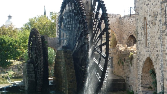 These 20-meter wide water wheels were first documented in the 5th century, representing an ingenious early irrigation system. Seventeen of the wooden norias (a machine for lifting water into an aqueduct) survived to present day and became Hama's primary tourist attraction, noted for their groaning sounds as they turned. Heritage experts documented several wheels being burned by fighters in 2014.