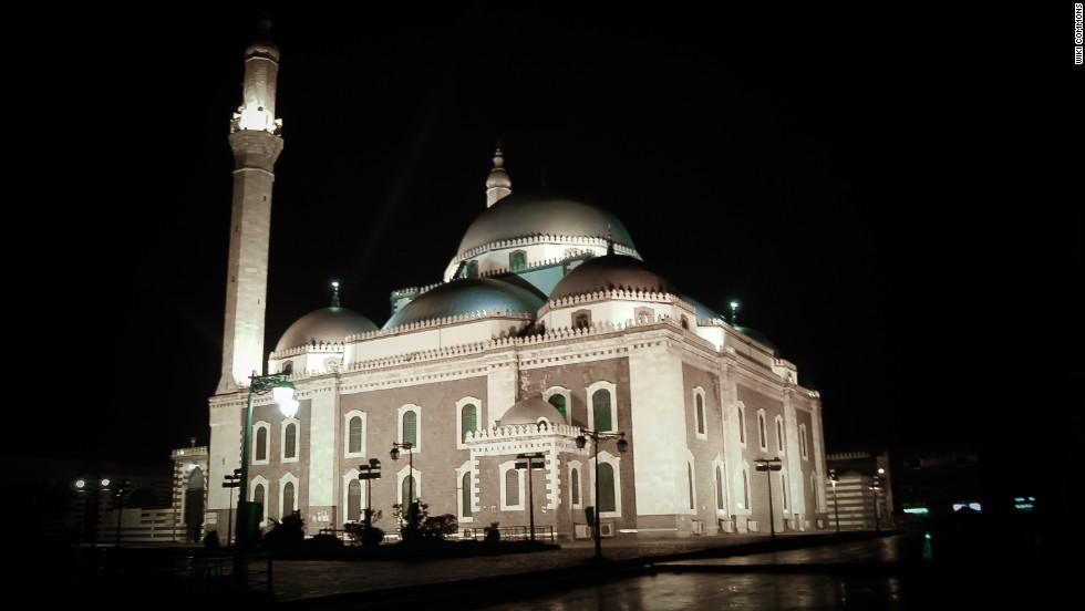 "Among Syria's most famous Ottoman-style mosques, which also shows <a href=""http://www.metmuseum.org/toah/hd/maml/hd_maml.htm"" target=""_blank"">Mamluk</a> influence through its light and dark contrasts. The vast site became a hub of the battle for Homs, itself a front-line of the conflict. The sacred mausoleum has <a href=""http://www.apsa2011.com/index.php/en/provinces/homs/monuments/634-homs-state-of-the-bombing-of-khalid-ibn-al-walid-mosque-29-06-2013.html"" target=""_blank"">been completely destroyed</a><strong>,</strong> and much of the interiors burned."