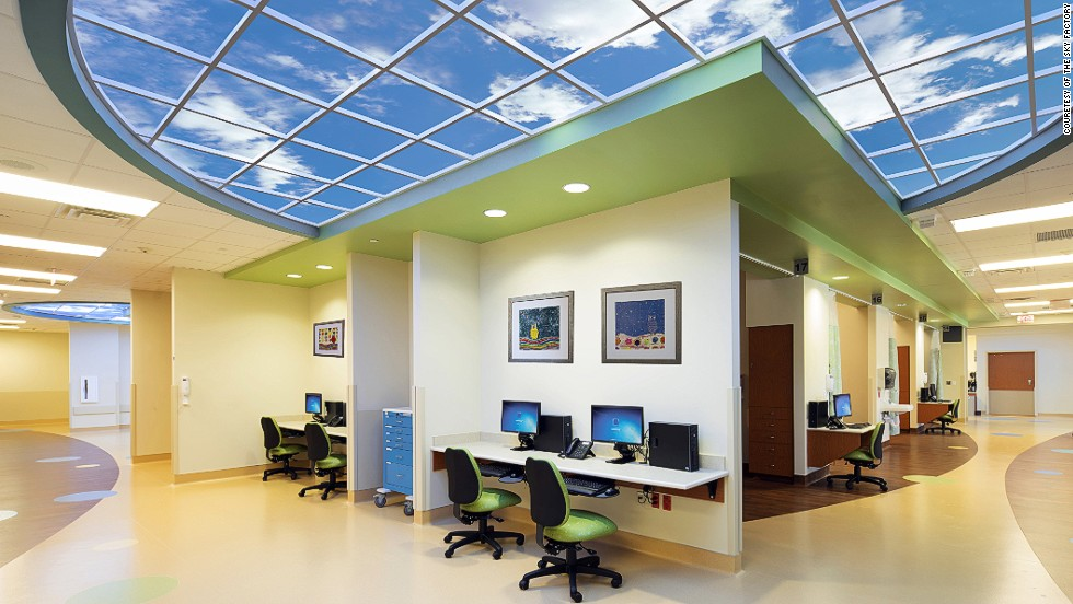 "The Sky Factory specialize in ""illusions of nature."" Their trademark Luminous SkyCeilings, pictured, are photographic illusions of real skies. Research indicates that illusory skies engage areas of the brain involved in spatial cognition, triggering a ""relaxation response."""
