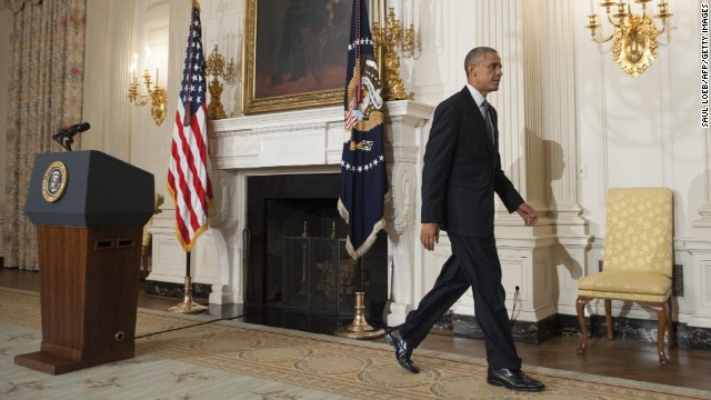 "US President Barack Obama leaves after addressing the situation in Iraq in the State Dining Room at the White House in Washington, DC, August 7, 2014. Obama said he authorized air strikes and relief supply drops in Iraq to prevent ""genocide"" by Islamist extremists against minorities. ""We can act, carefully and responsibly, to prevent a potential act of genocide,"" Obama said, in an address as he announced military action. At top is a portrait of 16th US President Abraham Lincoln.    AFP PHOTO / Saul LOEB        (Photo credit should read SAUL LOEB/AFP/Getty Images)"