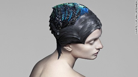 This headpiece, made of 4000 conductive Swarovski stones, changes color to correspond with localized brain activity.