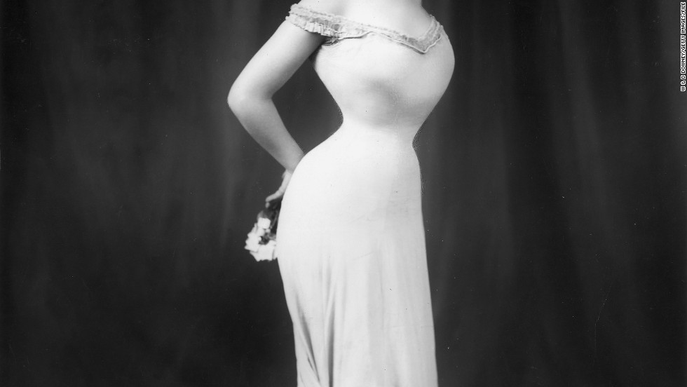 A new exhibition at London's Design Museum looks back at how women have used clothes to empower themselves. Danish-born actress Camille Clifford's trademark style was a long, elegant gown wrapped around her tightly corseted, 18-inch waist, pictured here in 1905.