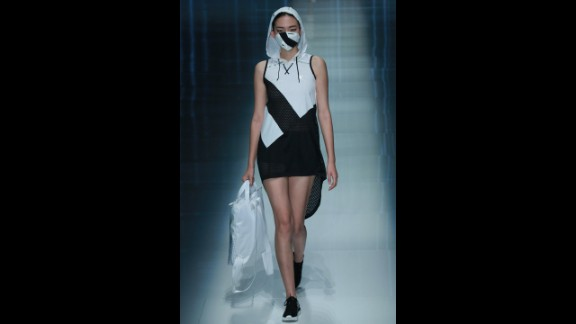 A model wears a look -- complete with a coordinating face mask -- for the spring/summer QIAODAN Yin Peng Sports Wear Collection.