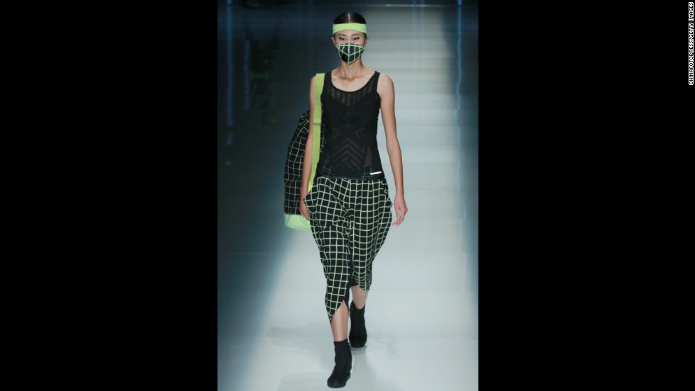 A model sports a face mask for the QIAODAN Yin Peng Sports Wear Collection.