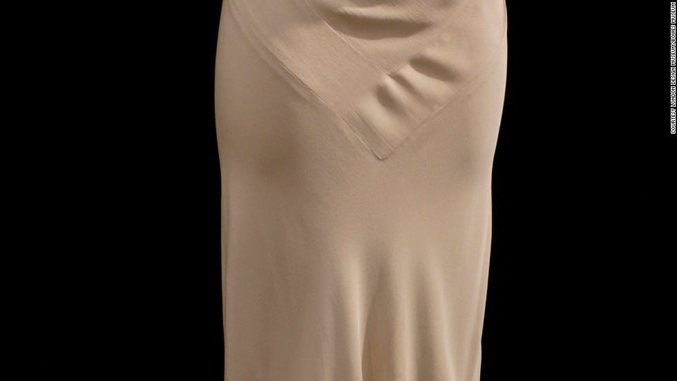 An evening gown of silk crêpe, satin-backed, from 1932, appears in the exhibition.