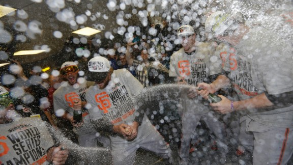 The San Francisco Giants celebrate after Game 7 of the World Series against the Kansas City Royals, October 29, in Kansas City, Missouri. The Giants won 3-2 to win the series.