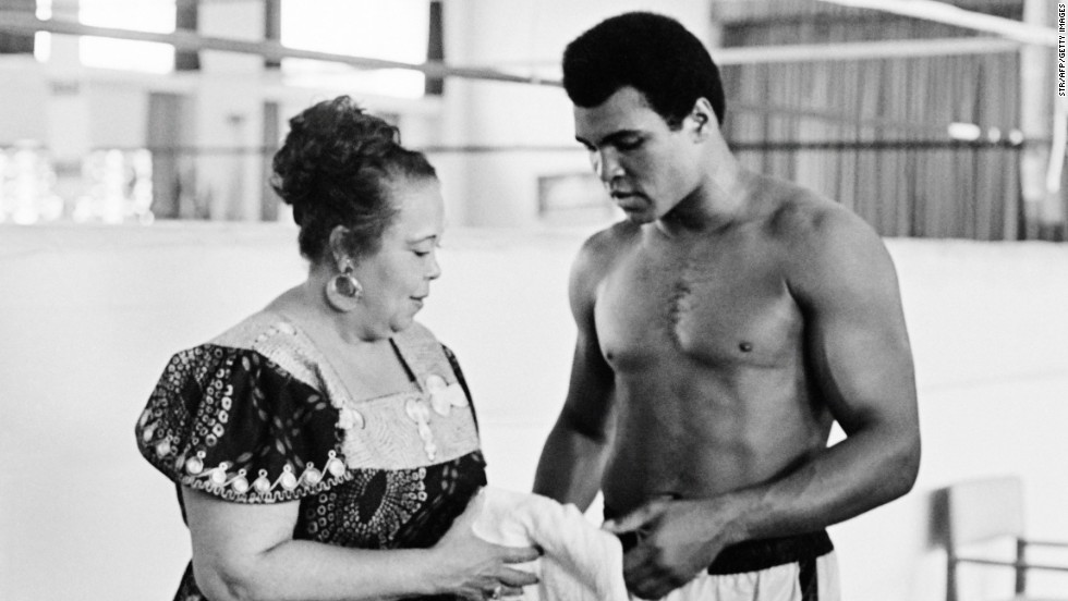 "Ali's mother, Odessa Lee Clay, tends to her son three days before the fight. ""I always felt like God made Muhammad special,"" she said of Ali, ""but I don't know why God chose me to carry this child."""