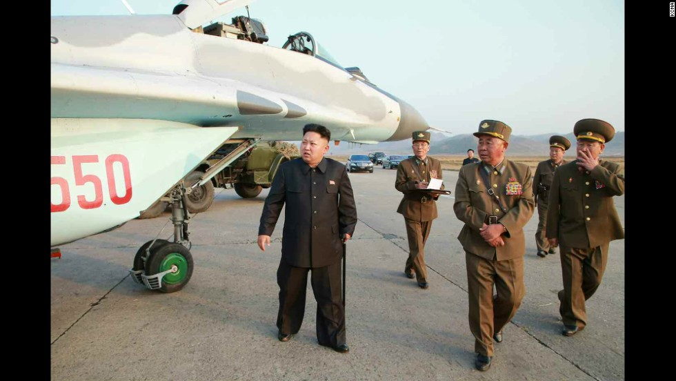 Kim is seen walking with a cane in this image released Thursday, October 30, by the state-run Korean Central News Agency.
