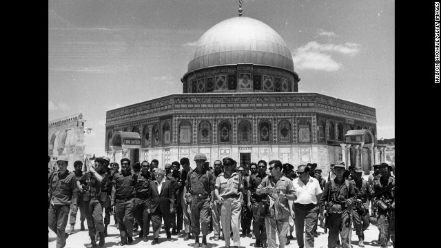 In June 1967, Israeli statesman David Ben-Gurion and Yitzhak Rabin lead a group of soldiers past the Dome of the Rock on the Temple Mount, on a victory tour following the Six Day War.