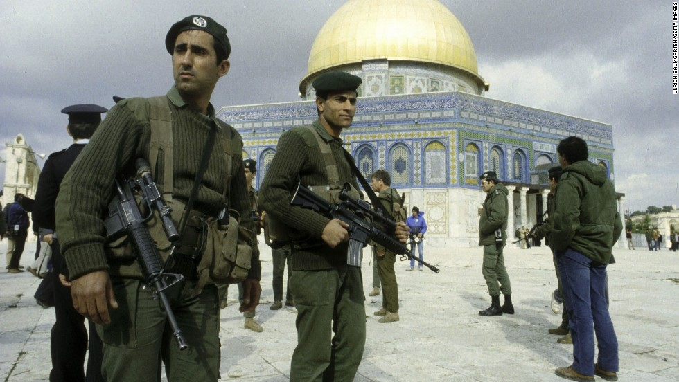 Israeli soldiers are seen in front of the Dome of the Rock in October 1990.