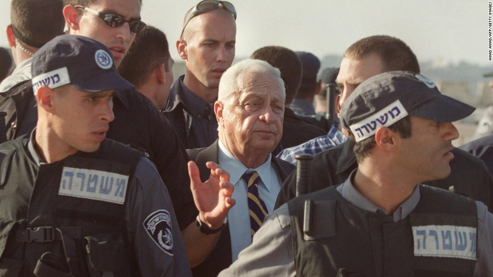 Ariel Sharon, then a candidate for Israeli prime minister, is flanked by security guards as he leaves the al-Aqsa Mosque compound in September 2000. The Second Intifada, a five-year Palestinian uprising, was sparked by Sharon's visit, Palestinians say. Sharon insisted that his visit was not intended to provoke Palestinians, but many saw it as an attempt to underline Israel's claim to Jerusalem's holy sites.