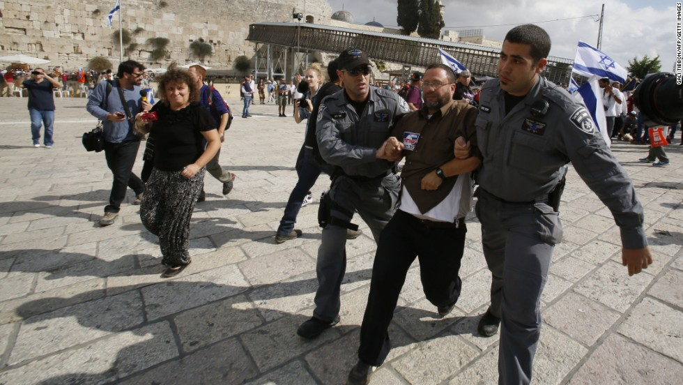 "Israeli police detain activist Noam Federman after he tried to enter the Temple Mount on Thursday, October 30, in Jerusalem. Israel says it temporarily closed access to the Temple Mount ""to prevent disturbances"" after the drive-by shooting of controversial activist Rabbi Yehuda Glick. Israel partially reopened access to the Temple Mount for Muslim prayers Friday."
