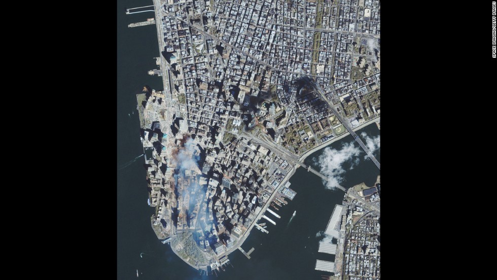 Four days after the September 11 attacks, this satellite image shows the remains of the World Trade Center buildings.