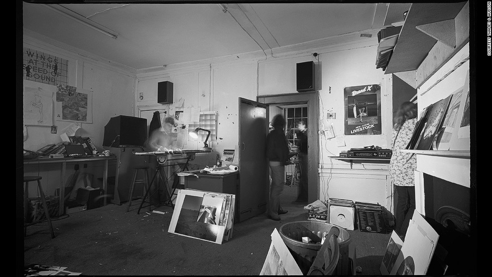 "This was where the magic happened: the Hipgnosis photographic studio at 6, Denmark St, Soho, London. ""It looked more like a scruffy garment factory than a photo-design workshop,"" says Po. ""In the back room a makeshift wooden shed covered in brown cork sufficed as a darkroom, and the acrid smell of fixing fluid presided over any meeting that was held in a communal hallway... Beyond lay a scruffy bathroom, complete with Victorian roll-top bath and a porcelain basin, which were used in turn as a print washer and urinal."""