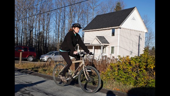 Kaci Hickox leaves her home in Fort Kent, Maine, to take a bike ride with her boyfriend on October 30, 2014. Hickox, a nurse, recently returned to the United States from West Africa, where she treated Ebola victims. State authorities wanted her to avoid public places for 21 days -- the virus' incubation period. But Hickox, who twice tested negative for Ebola, said she would defy efforts to keep her quarantined at home.