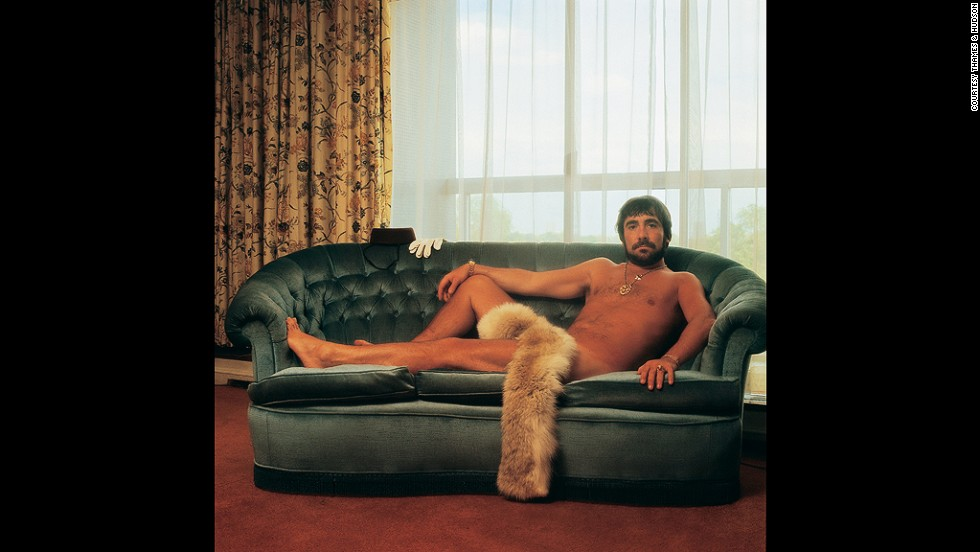 "This portrait of Keith Moon, the drummer of The Who, was taken in the Royal Garden Hotel in London in 1976. ""The band wanted a sort of Playboy feel, and Keith came up with the idea of getting naked for a centrefold shot,"" recalls Po. ""I turned up at the hotel, and there he was in all his glory. He grabbed his girlfriend's boa and put it over his privates. The picture makes him look like a sedate musician with a beautiful body, but he was mad as a hatter. He spoke with an affected, very posh accent the whole time. There was an upturned chest of drawers on the bed, and for some reason all the sheets and blankets had been stuffed into the toilet."""