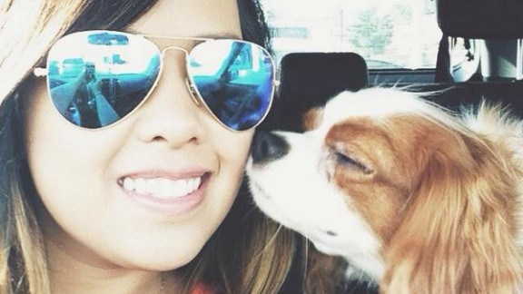 Nina Pham rides with her dog, Bentley, as seen in this photo from Facebook. After Pham's treatment for Ebola and Bentley's quarantine, the two were reunited Saturday.