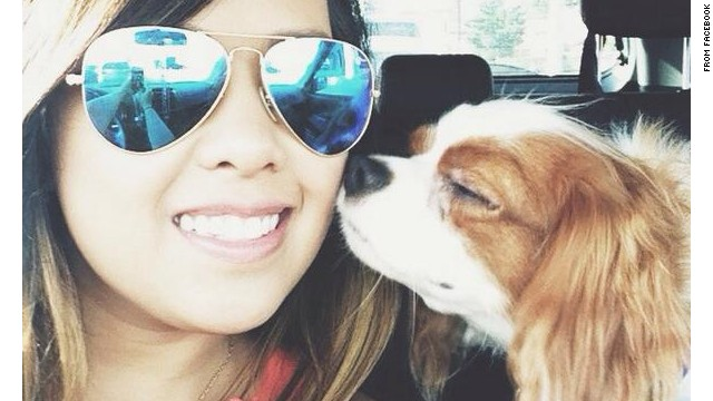 Nina Pham rides with her dog, Bentley, as seen in this photo from Facebook. After Pham's treatment for Ebola and Bentley's quarantine, the two will be reunited Saturday.