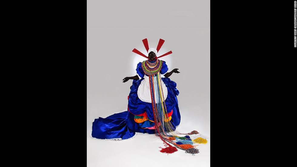 "<em>Mary Sibande, Her Majesty, Queen Sophie, 2010 </em><br /><br />""We're also looking at how artists explore the fictional artistic photographic archives, looking at the way that historical images and vernacular images are used on a more contemporary basis,"" Gergel says. <a href=""http://www.gallerymomo.com/artists/mary-sibande/images/index/"" target=""_blank"">Mary Sibande</a>'s <em>Long Live the Dead Queen</em> series, for example, juxtaposes Victorian finery and maid uniforms to comment on feminine identity in post-apartheid South Africa.<br /><br />""In many ways, recontextualizing that type of imagery puts it into a new conversation."""