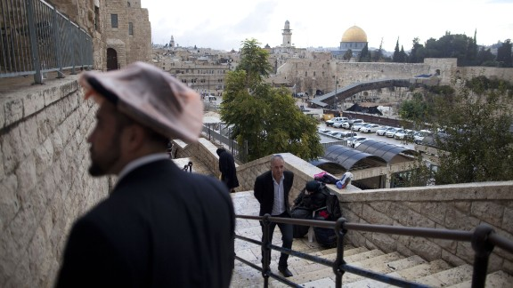 Israelis walk at the Jewish quarter in the Old City overlooking the Temple Mount on October 31.