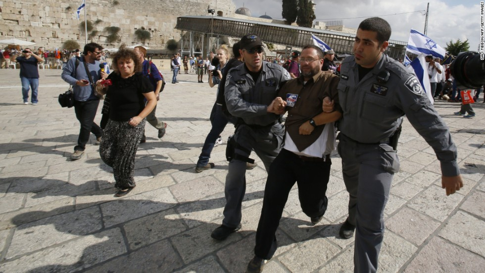 "Israeli police detain activist Noam Federman after he tried to enter the Temple Mount on Thursday, October 30. The closing of the holy site -- the first in more than a decade -- infuriated Palestinians, with a spokesman for Palestinian President Mahmoud Abbas calling it a ""declaration of war."""