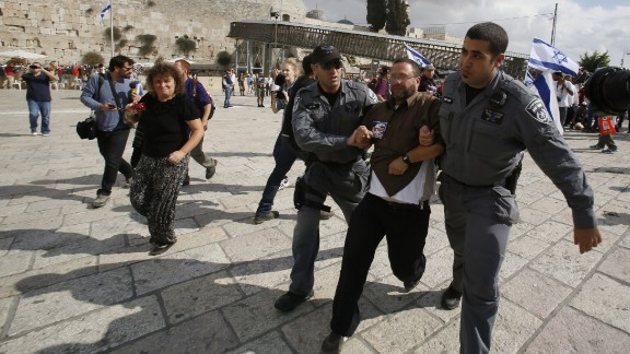 Israeli police detain activist Noam Federman after he tried to enter the Temple Mount in Jerusalem on Thursday, October 30.