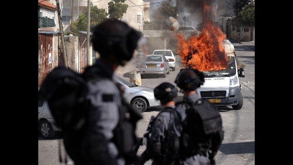 A van burns in Jerusalem during clashes between Palestinians and Israeli security forces on October 30.
