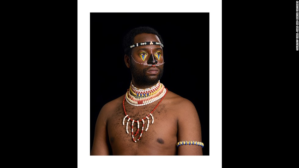 "<em>Karl Ohiri and Riikka Kassinen, The Medicine Man: I''ll Take Care of You, 2013</em><br /><br />When deciding which photographers to feature, LagosPhoto organizers were particularly drawn to those exploring self-portraiture. ""They're becoming actors in front of the camera and looking at how they define themselves as artists, as Nigerians and as Africans."""