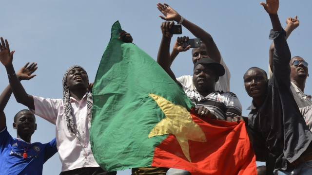 Burkinese celebrate after embattled President Blaise Compaore announced that he was stepping down in Ouagadougou on October 31, 2014.