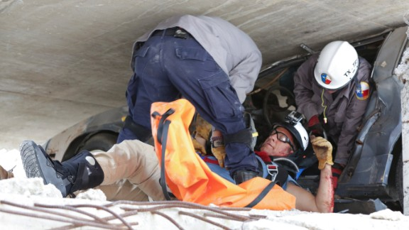 "Mike Rowe, host of CNN's ""Somebody's Gotta Do It,"" gets rescued by Texas A&M paramedics during a training exercise. Click through the gallery for more images of folks who #GottaDoIt and watch CNN in 2015 for Season 2."