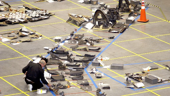 Investigators inspect debris from the space shuttle Columbia, which broke up over East Texas in February 2003. Seven astronauts were killed.