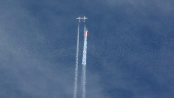The Virgin Galactic SpaceShipTwo rocket separates from the carrier aircraft before exploding in the air during a test flight on Friday, October 31. The explosion killed a pilot aboard and seriously injured another person while scattering wreckage in Southern California's Mojave Desert, witnesses and officials said.