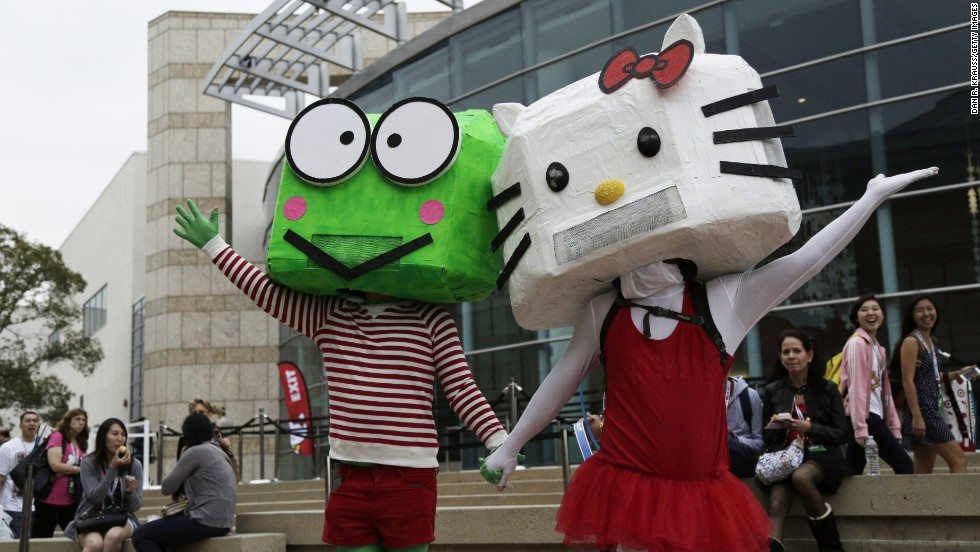 Mascots pose outside the convention.