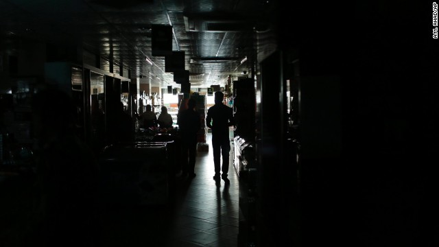 A Bangladeshi man walks in a shopping mall during a blackout in Dhaka, Bangladesh.