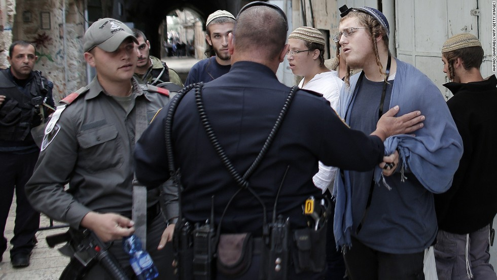 "Right-wing Israelis are stopped by Israeli policemen as they try to access the al-Aqsa Mosque compound, part of the Temple Mount, on November 2. <a href=""http://www.cnn.com/2014/10/30/middleeast/gallery/temple-mount/index.html"">The Temple Mount</a> is the holiest site in Judaism and the third-holiest site in Islam."