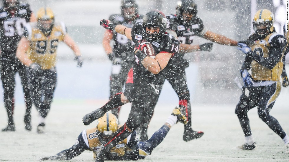 Matt Walter of the Calgary Stampeders runs the ball against the Winnipeg Blue Bombers during a CFL game played Saturday, November 1, in Calgary, Alberta. Walter rushed for 109 yards in the game, but Winnipeg won 18-13.