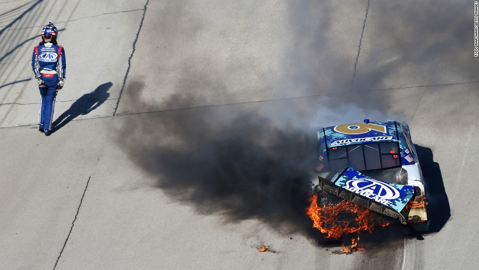 NASCAR driver Trevor Bayne stands near his car after crashing during the Nationwide Series race Saturday, November 1, at Texas Motor Speedway.