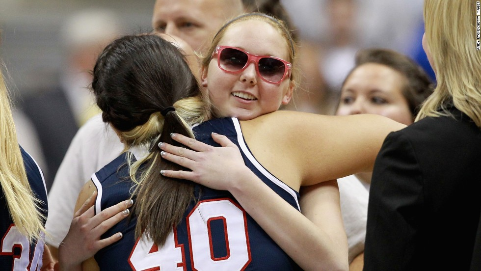 "College basketball player Lauren Hill, wearing sunglasses, hugs an opponent Sunday, November 2, before playing her team's season opener in Cincinnati. Hill, a freshman at Mount St. Joseph University, has terminal brain cancer, and the NCAA granted her team a special waiver so it could start its season early. Hill <a href=""http://bleacherreport.com/articles/2253368-terminally-ill-cancer-patient-lauren-hill-scores-in-college-basketball-game"" target=""_blank"">scored the opening basket</a> in the game and finished with four points."
