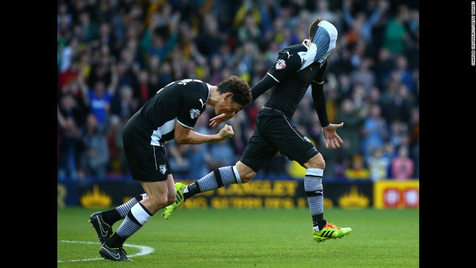 Daniel Tozser, right, and Watford teammate Keith Andrews celebrate Saturday, November 1, after Tozser scored a goal against Millwall in Watford, England. With a 3-1 victory, Watford moved to the top of the Championship, which is the second tier of professional soccer in England.