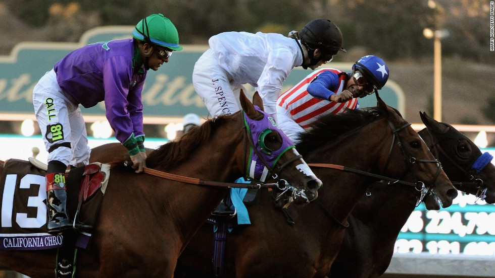 Martin Garcia, atop Bayern on the right, celebrates after winning the Breeders' Cup Classic on Saturday, November 1, in Arcadia, California.