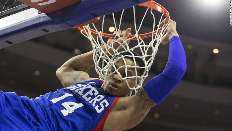 K.J. McDaniels of the Philadelphia 76ers hangs onto the rim after a dunk against Miami on Saturday, November 1.