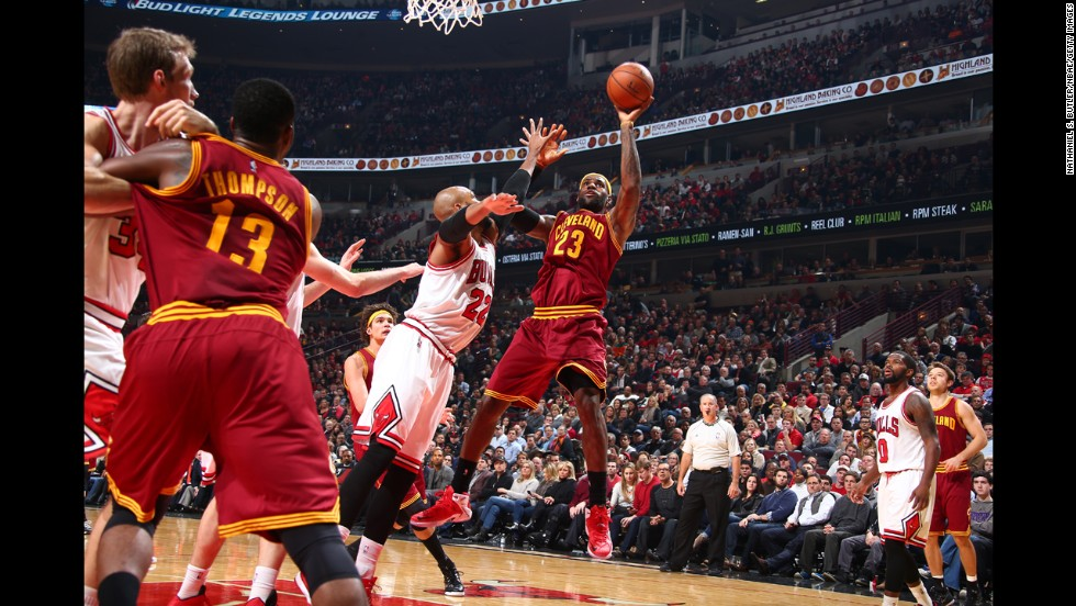 Cleveland's LeBron James shoots the ball during a game at Chicago on Friday, October 31. The Cavaliers defeated the Bulls in overtime to give James his first regular-season win since returning to Cleveland.