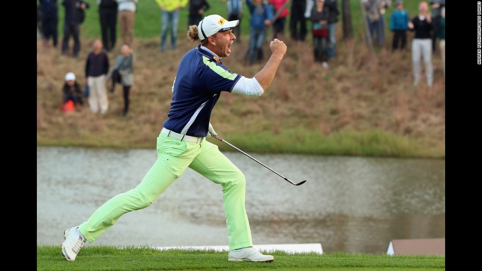 Marcel Siem celebrates after chipping in for a birdie to win the BMW Masters in a playoff Sunday, November 2, in Shanghai, China.
