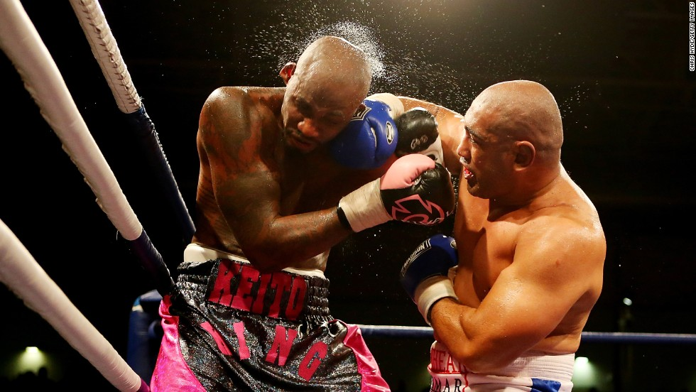Alex Leapai punches Malik Scott during a heavyweight fight in Brisbane, Australia, on Friday, October 31. Scott won the bout by unanimous decision.