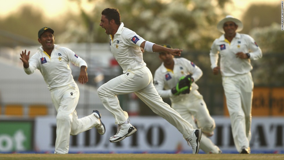 Pakistan's Imran Khan celebrates after taking the wicket of Australia's Chris Rogers during the second day of a Test match Friday, October 31, in Abu Dhabi, United Arab Emirates. Pakistan won the match by 356 runs.